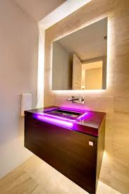 m led light wall mirror for modern bathroom combined with brown plywood veneer floating vanity cabinet with purple led sink vanity bathroom vanity lighting ideas combined