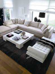 a dark rug to contrast my beige sectional and light wood floors beige sectional living room