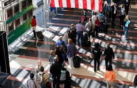 senate passes bill that would boost airport security newshour a line of passengers wait to enter the security checkpoint before boarding their aircraft at reagan