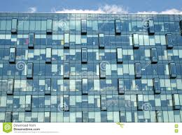 modern office building glass wall front view close up stock photo building an office
