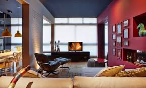 black painted ceiling in awesome living room beside kicthen ideas with red round coffee table and beige sofa also red wall with many framed artworks on it awesome black painted
