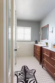 bathroom refresh: white subway tile with dark black grout bathroom jonathan adler touches zebra rug and bathroom refresh