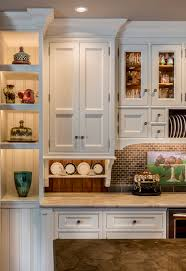 st charles kitchen cabinets: image of a traditional white kitchen featuring amazing display and storage areas for dishes and decorative accents gas grill in st charles il