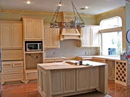 beech wood kitchen cabinets: cherry display cabinets over pass through cherry kitchen with paneled counter