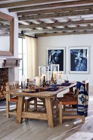 dining room khaki tone: ralph lauren homes rustic dining table in barn door oak sets a warm inviting tone