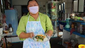 thailand photo essay months photos emmy aka the greatest chef in thailand cooking her signature pad kra pao gai kai dao there is definitely a big smile under her mask