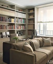 contemporary officelibrary by mr architecture decor in new york new york in a manhattan study the sofa is covered in a holly hunt velvet beautiful home office den