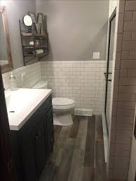 country themed reclaimed wood bathroom storage: remodel modern rustic bathroom with white subway tile and quotreclaimed woodquot ceramic tile floor i would do this with actual reclaimed wood flooring and blue