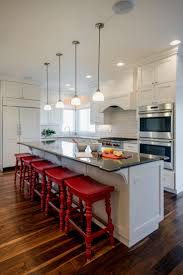 island design ideas designlens extended: wite kitchen with red saddle bar stools kitchen with mini pendant lights over white kitchen island with black countertops more