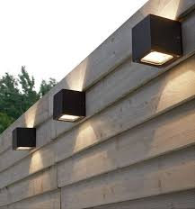 these would be neat to have along the fence in the back yard it keeps the yard lit but with dim light to still give it that awesome chill feel at night awesome modern landscape lighting design ideas bringing