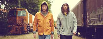 Two Guys Wearing Hooded Jackets - Surf Dome