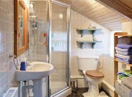 shower room with washbasin and wc including ample storage space ample shower room