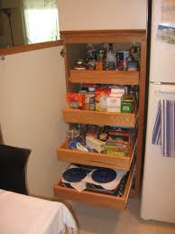 beech wood kitchen cabinets: close up of open drawers with flatware trays in solid beech best kitchen cabinet shelving