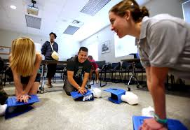 palm beach gardens high school teens careers gain from golf hannah carlo far right a senior in the palm beach gardens high school medical magnet program instructs madison waite left kneeling of royal palm beach