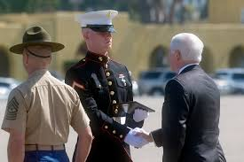 u s department of defense photo essay defense secretary robert m gates presents an award to a marine honor grad during his
