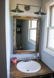 i redid two bathrooms in my old house and have three more to go in my new house and i had a very mixed style in my master bathroom i preferred a bathroom vanity lighting ideas