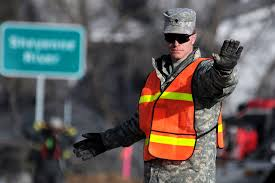 u s department of defense photo essay u s army spc danny gross directs traffic at an intersection in lisbon n d