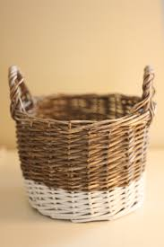 diy painted wicker baskets the key is to make sure you press the tape down so it makes a decent s