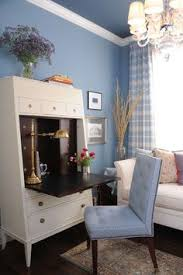 this modern secretary in a calming blue home office is perfect for some quick paperwork and blue home office dark wood