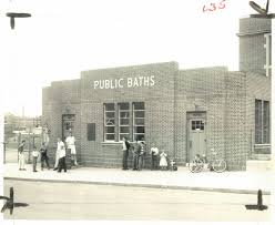 green bathroom screen shot: outside a public bath in  the year after the last public bath closed in baltimore baltimore sun