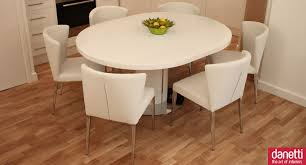 cream compact extending dining table: solid white expandable dining table set with round table on wooden floor for dining room ideas