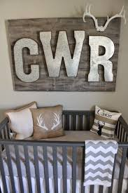 hunting and fishing nursery love this rustic monogram piece over the crib baby boy rooms
