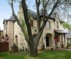 Plan W TX  Old World Charm   e ARCHITECTURAL designA stone facade and steep hip roof remind you of the Old World charm of Europe in this stunning narrow lot home plan