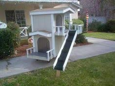 Selling this hand made two story dog house  Great condition    Wonderful two story doghouse   staircase