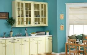 kitchen paint ideas with light wood cabinets and bin drawer pulls below metal glassware caddy against adorable blue paint colors
