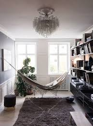 kitty otoole elegant whimsical bedroom: in a room for reading an elegant hammock puts in a surprise appearance over a moroccan beni quarain rug vitsoe shelving and a studioilse low bench