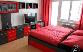 the combination red and black modular furniture adds visual interest and energy to this bedroom if you cant find pieces in these colors black bedroom furniture hint