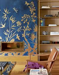 zones bedroom wallpaper: blue living room with gold wall detail