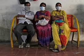 photos top images from around the world com n relatives of swine flu patients sit outside an isolation ward for swine flu at the