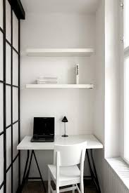 full size of office black laptop closed desk lamp on square table front simple white chair bright office room interior
