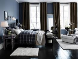 mix for a match using a rich deep blue wall color and lots of dark bedroom dark furniture
