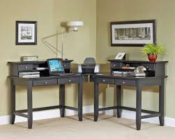 furniture desk home office designs the charming elegant gray brown two person office desks with drawers features picture walls a tree pot a lamp and rug charming office plants