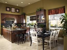 countertops dark wood kitchen islands table: open concept living area with tall ceilings kitchen opens up to dining area walls