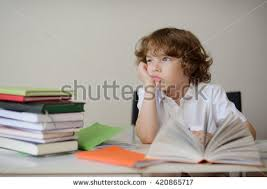 A child of primary school age do homework  The boy does his homework at his