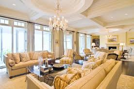cream couch living room ideas: amazing white formal living room with crystal chandelier above black acrylic table plus cream sofas