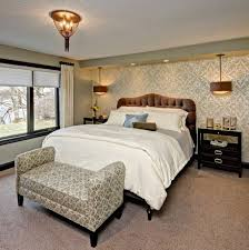 view in gallery master bedroom with a king sized bed and a bench with fun pattern bed bench furniture