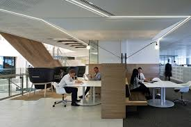 communal work tables and meeting rooms give staff a variety of options to move between anz office melbourne