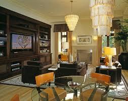 custom built entertainment center ideas living room contemporary with fireplace screen orange throw pillows media room cabinet lighting custom