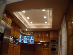 kitchen ceiling lighting design. i also like the different round lights it would match already elsewhere in our kitchen ceiling lighting design