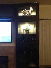 its just a besta cabinet glass doors and led lighting all from ikea here are more detailed pics besta lighting