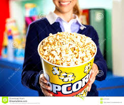 worker eating popcorn at cinema concession stand stock photo cover letter worker eating popcorn at cinema concession stand stock photo worker offering bucket midsection smiling