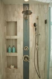 ideas shower systems pinterest: an accent stripe of glass tiles adds interest to this neutral shower sleek niches provide