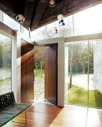 designer omer arbel insisted that not a single reclaimed plankstill marked by nailheads and chipped paintbe cut nor altered during construction architect omer arbel office click
