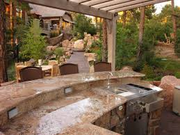patio outdoor stone kitchen bar:  stone patio with fireplace outdoor kitchen cabinets modern kitchen wrona neutral outdoor kitchen outdoor kitchen design ideas outdoor kitchen ideas
