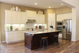 beech wood kitchen cabinets:  burrows cabinets kitchen in knotty alder with verona finish and appliance end panels