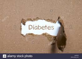 the word diabetes appearing behind torn paper stock photo royalty stock photo the word diabetes appearing behind torn paper